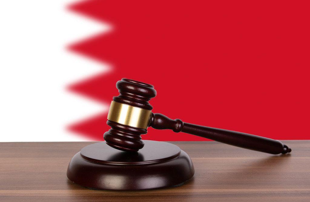Wooden gavel and flag of Bahrain