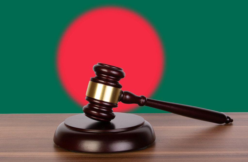 Wooden gavel and flag of Bangladesh