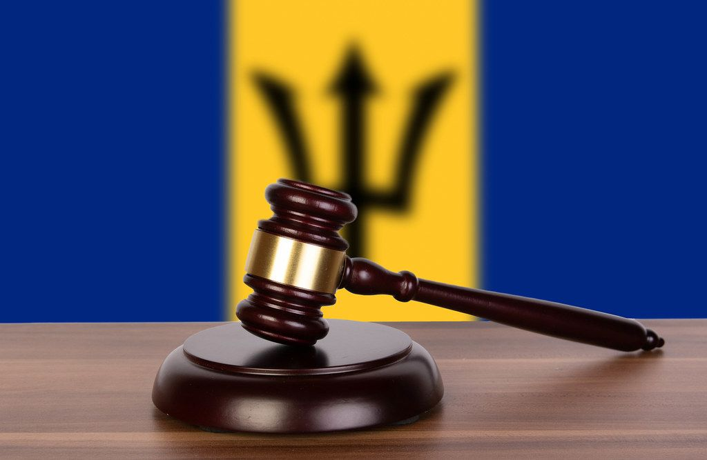 Wooden gavel and flag of Barbados