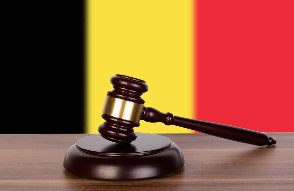 Wooden gavel and flag of Belgium