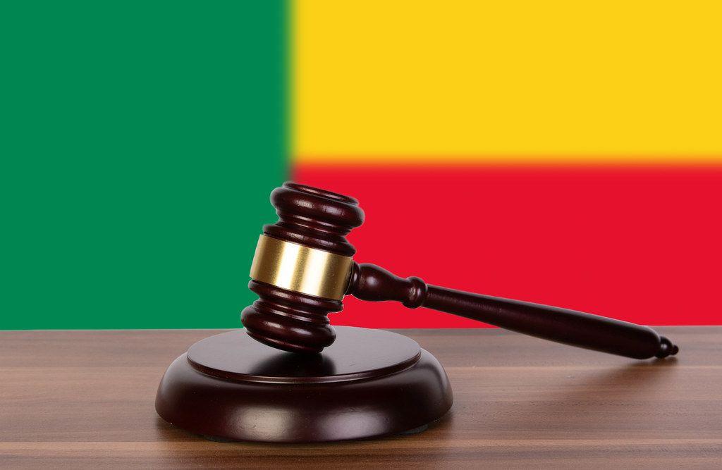 Wooden gavel and flag of Benin