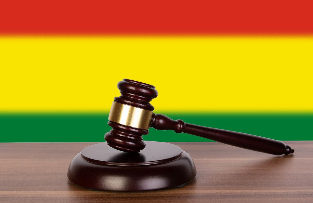 Wooden gavel and flag of Bolivia