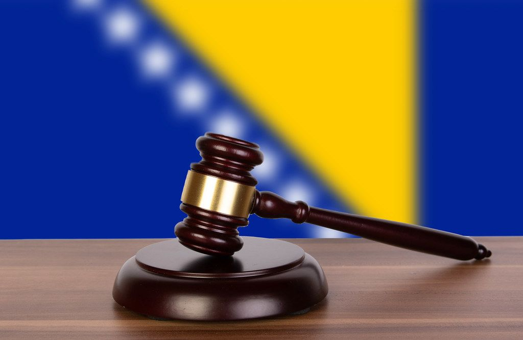 Wooden gavel and flag of Bosnia and Herzegovina