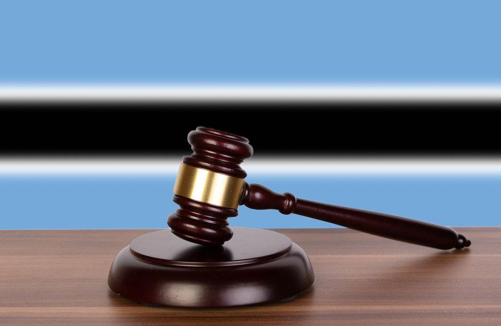 Wooden gavel and flag of Botswana