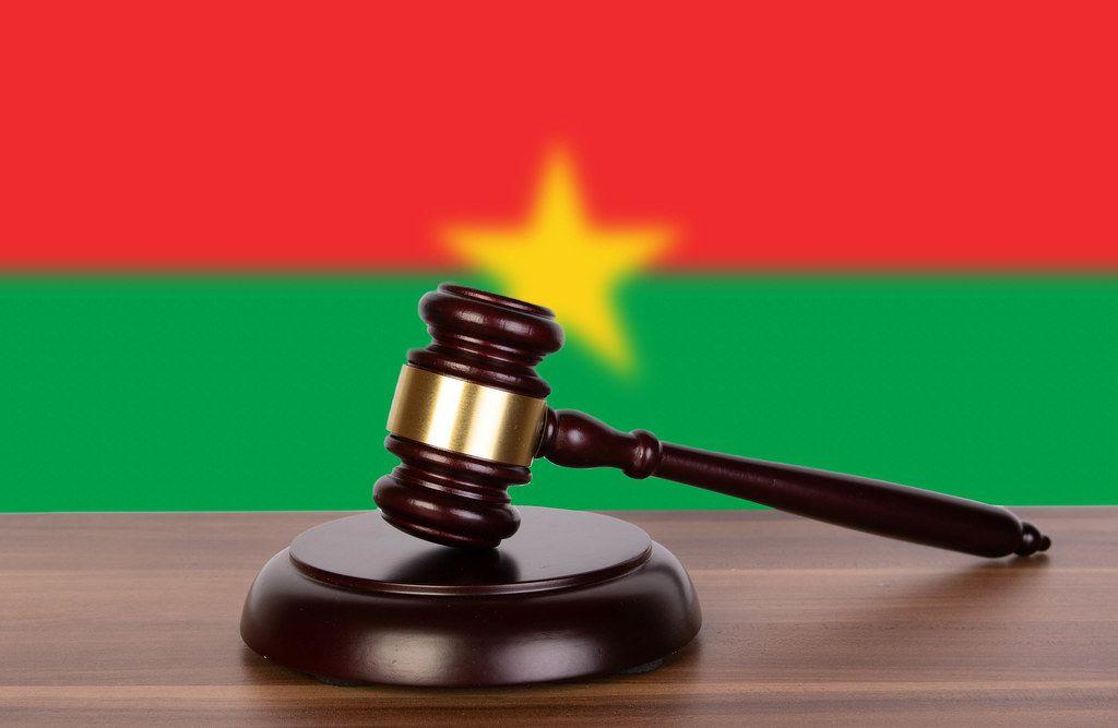 Wooden gavel and flag of Burkina Faso