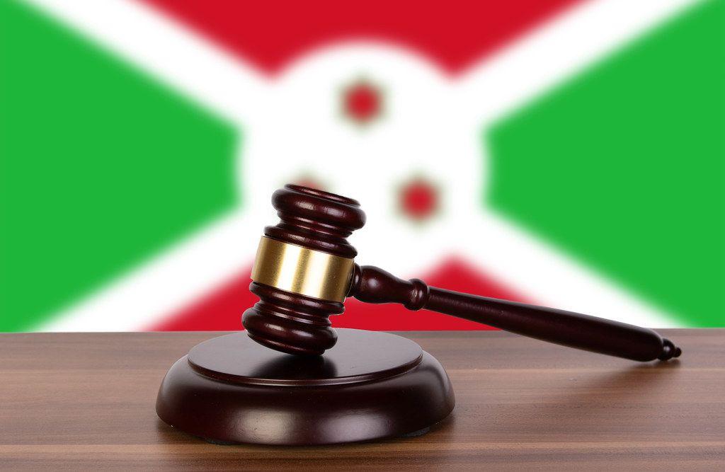Wooden gavel and flag of Burundi