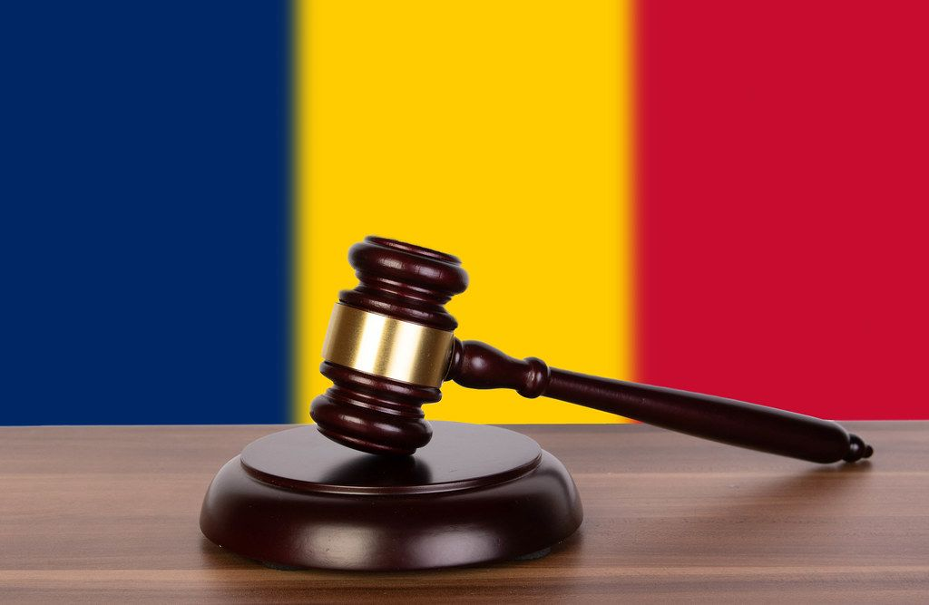 Wooden gavel and flag of Chad