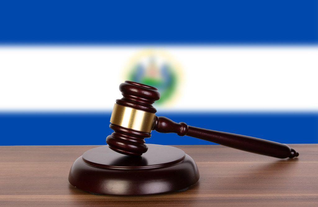 Wooden gavel and flag of El Salvador