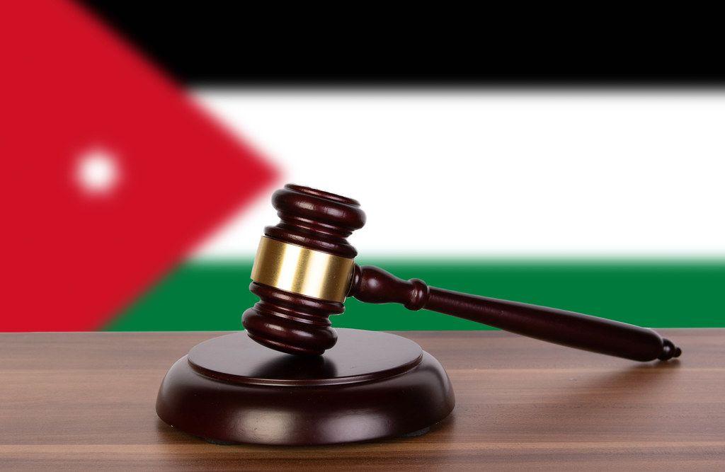 Wooden gavel and flag of Jordan