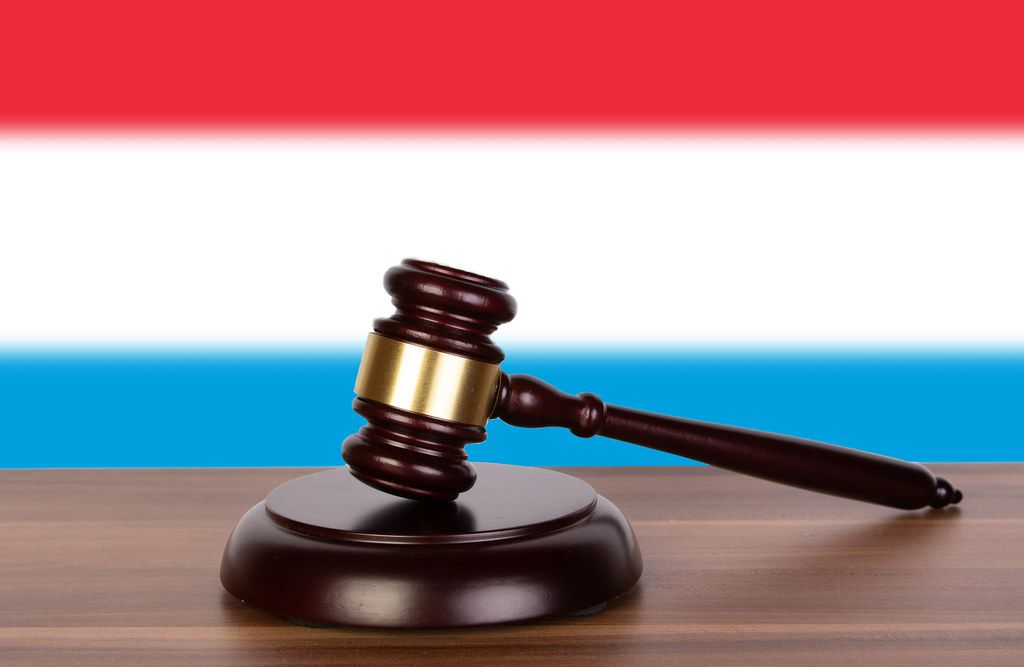 Wooden gavel and flag of Luxembourg