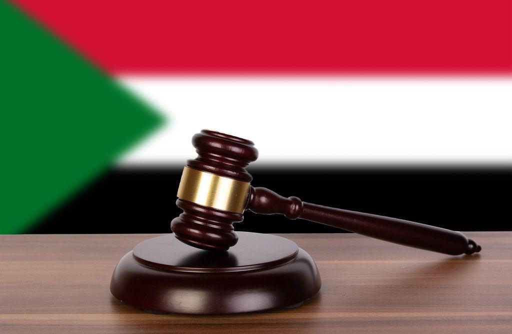Wooden gavel and flag of Sudan