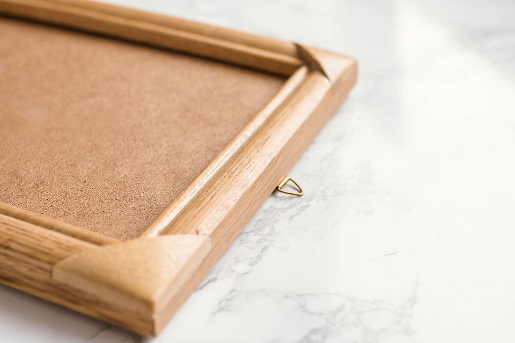 Wooden photo frame on marble background. Close up.