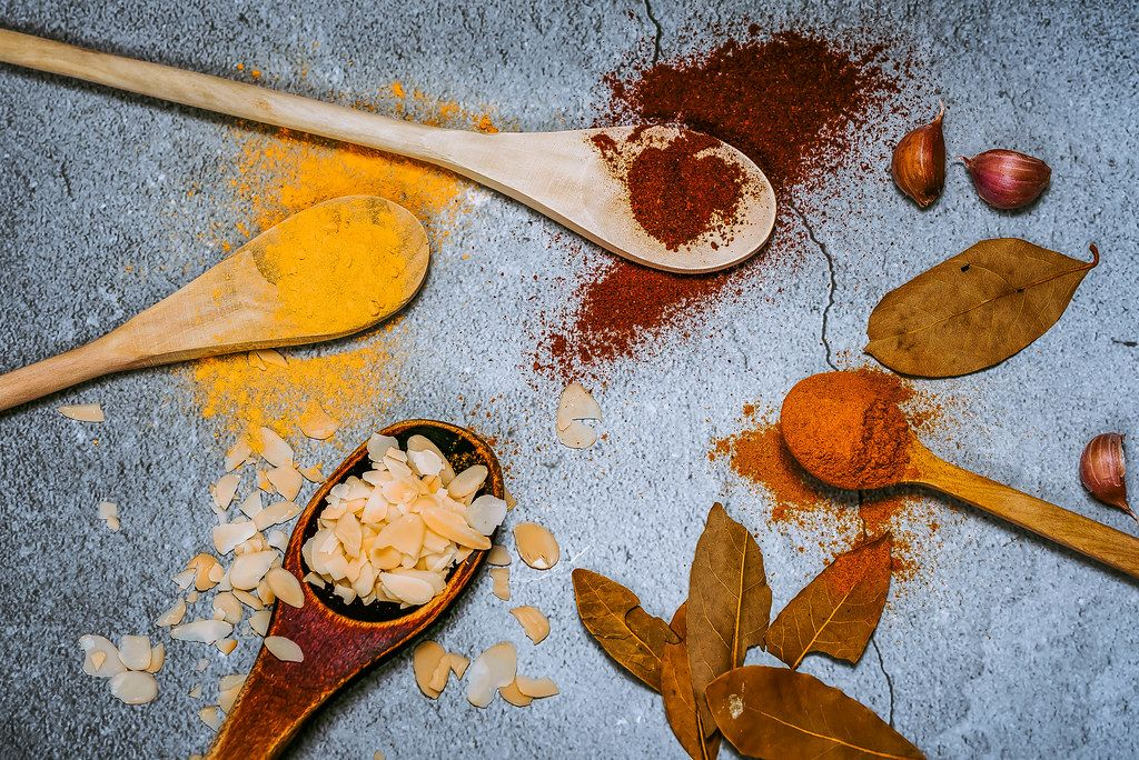 Wooden spoons with spices.
