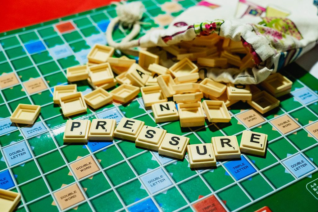 Word -Pressure- on spilled scrabble from pouch.jpg