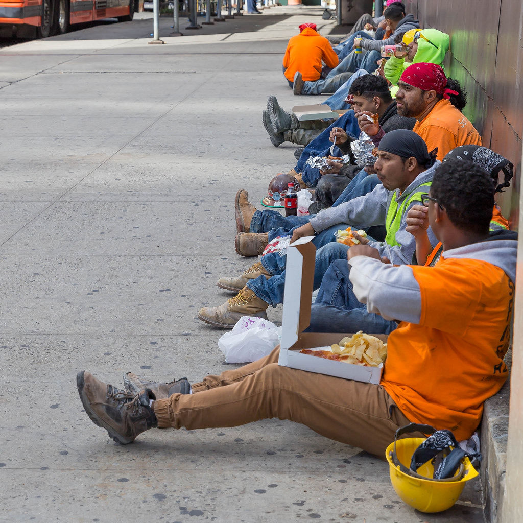 Workers having their lunch on the streets of New York