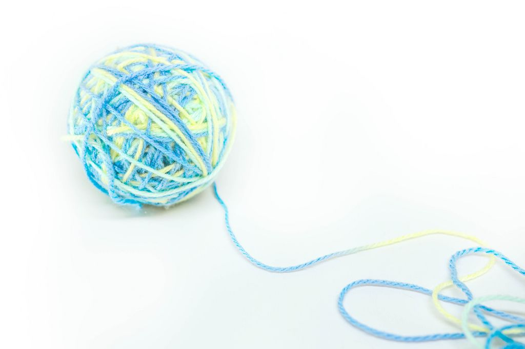 Yarn ball on white background