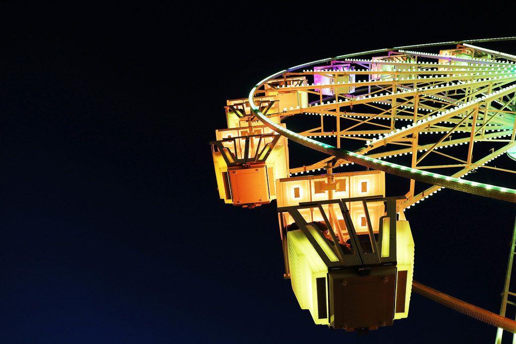 Yellow Ferris wheel, close-up view