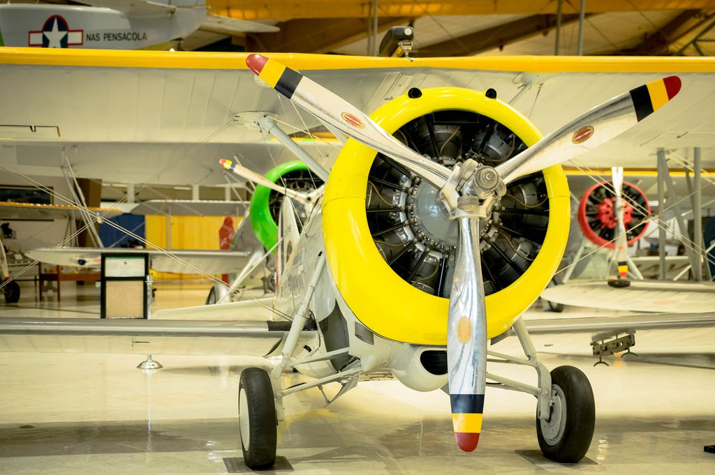 Yellow three propeller plane