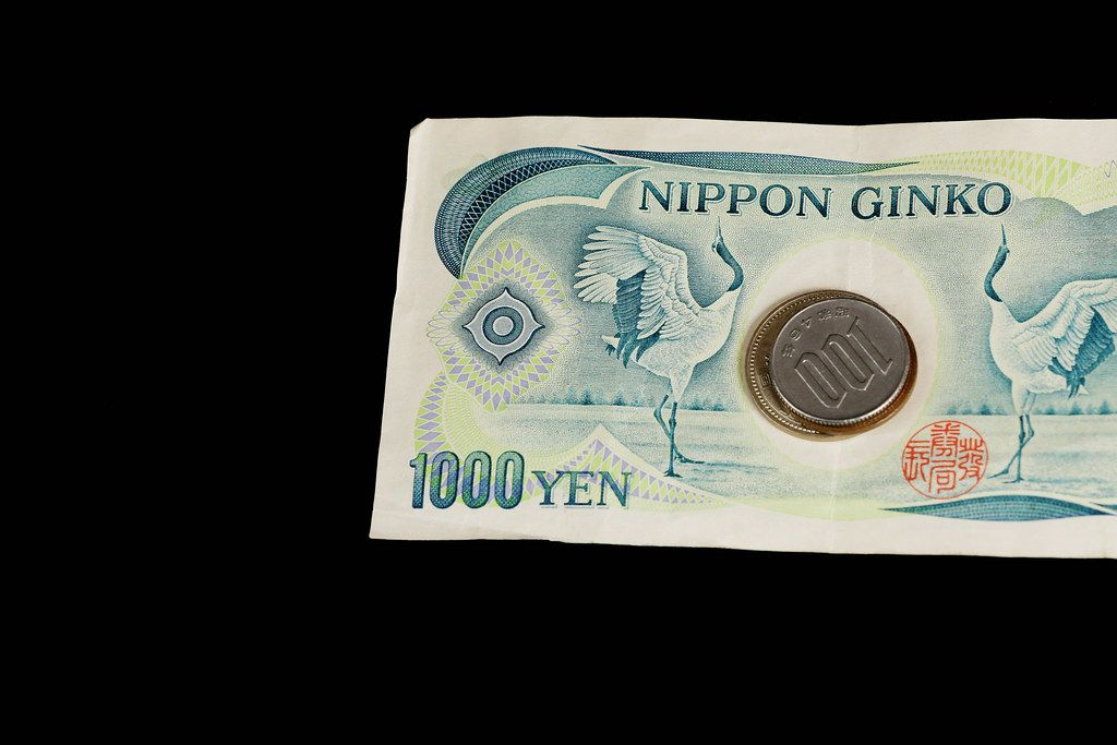 Yen, Japanese banknotes and coins, black background