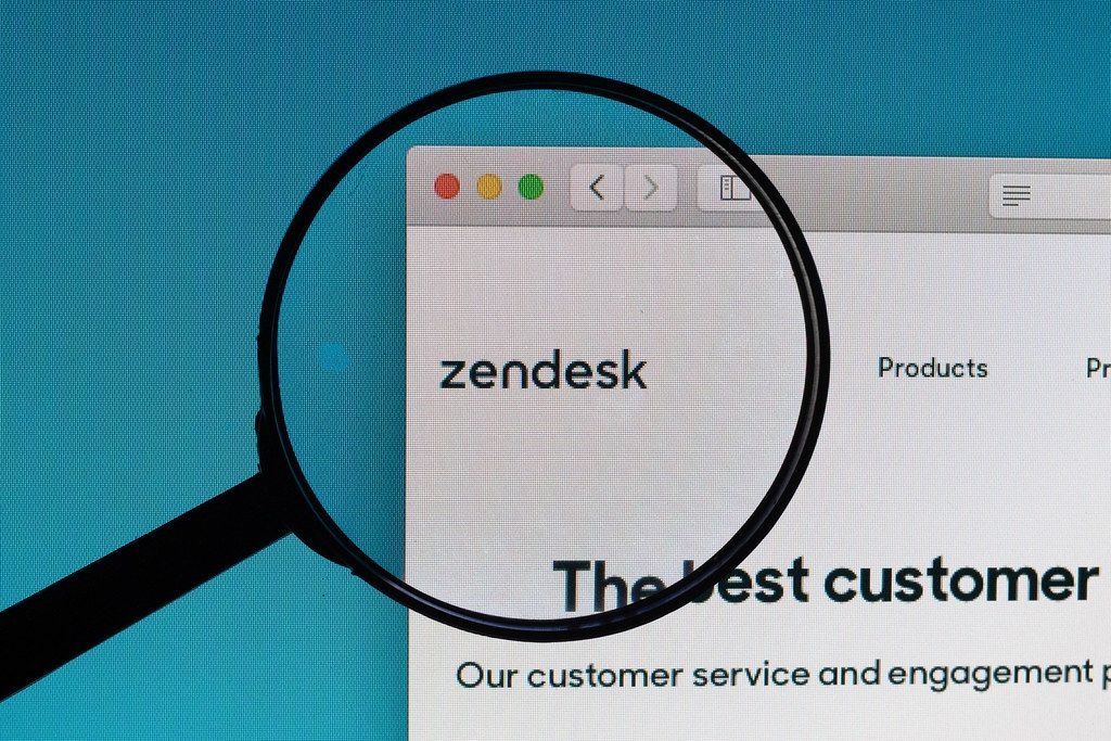 Zendesk logo under magnifying glass