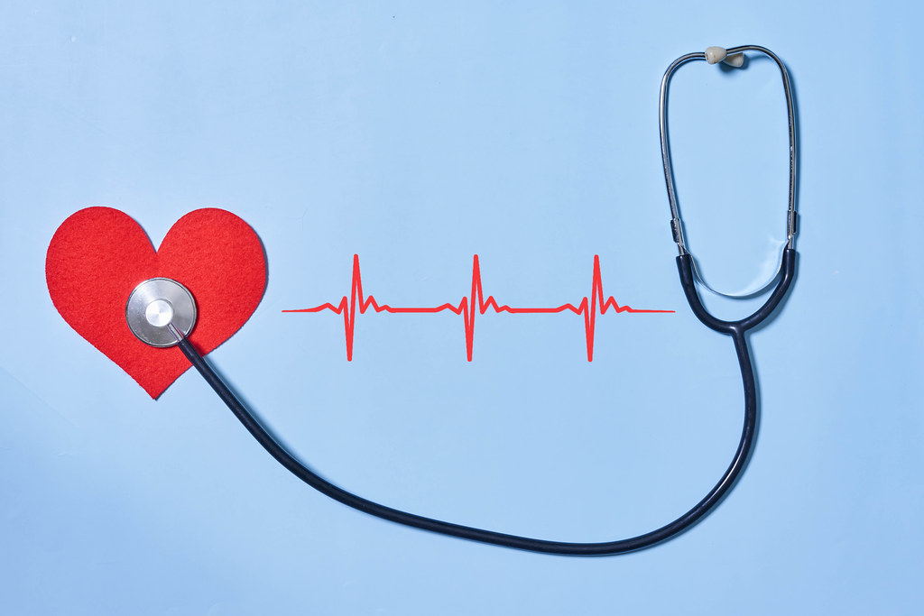 12. Red heart and stethoscope with cardiogram