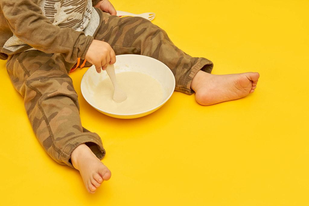 2 years old kid eating healthy porridge