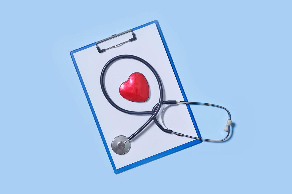 8. Stethoscope and heart on blue background