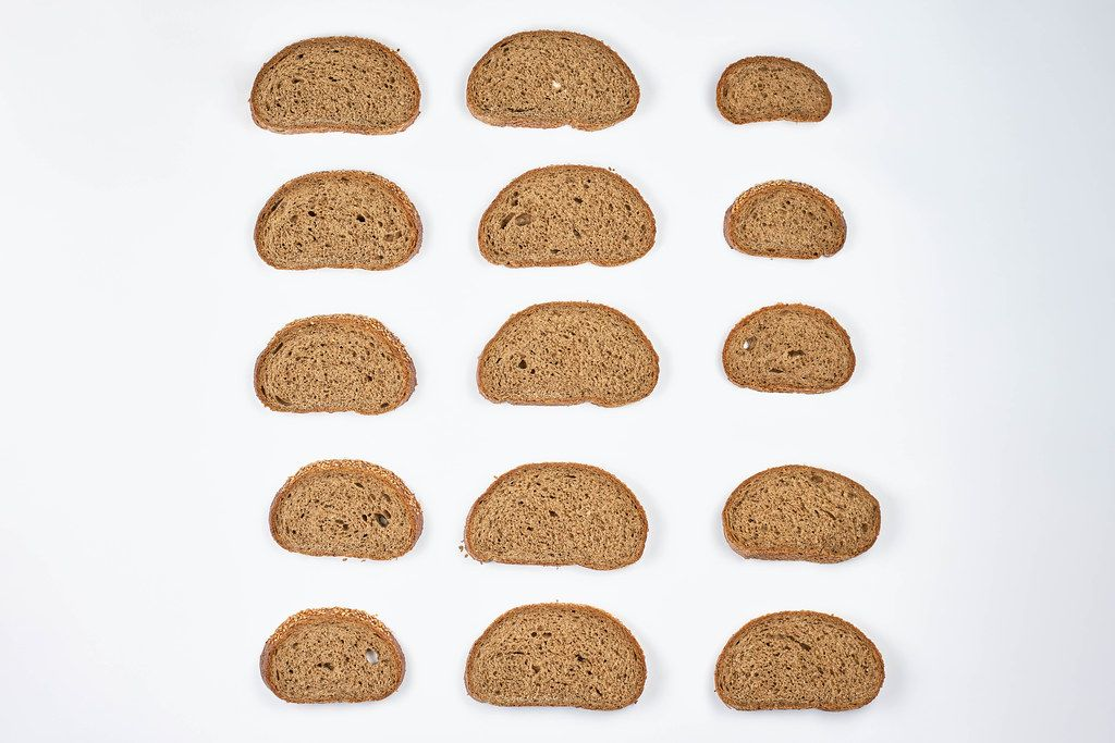 A beautiful arrangement of bread slices on white background