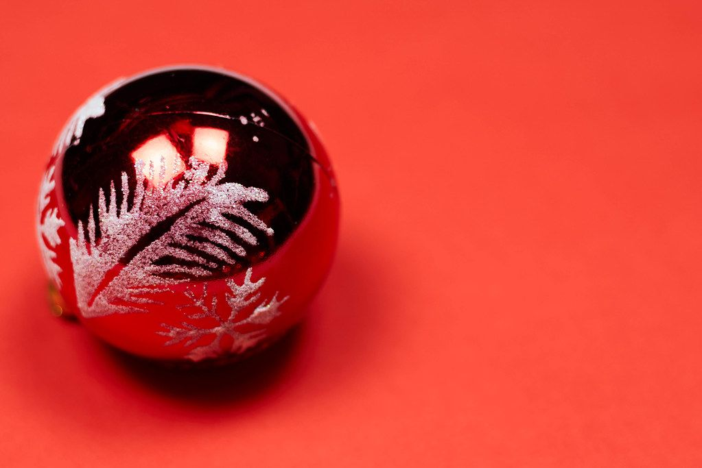 A big Christmas tree ball on a red background