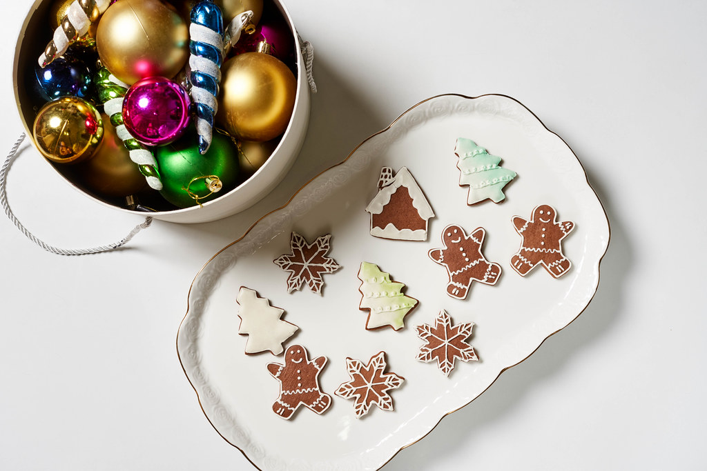 A big plate of sweet Xmas festive cookies and box of Christmas decorations