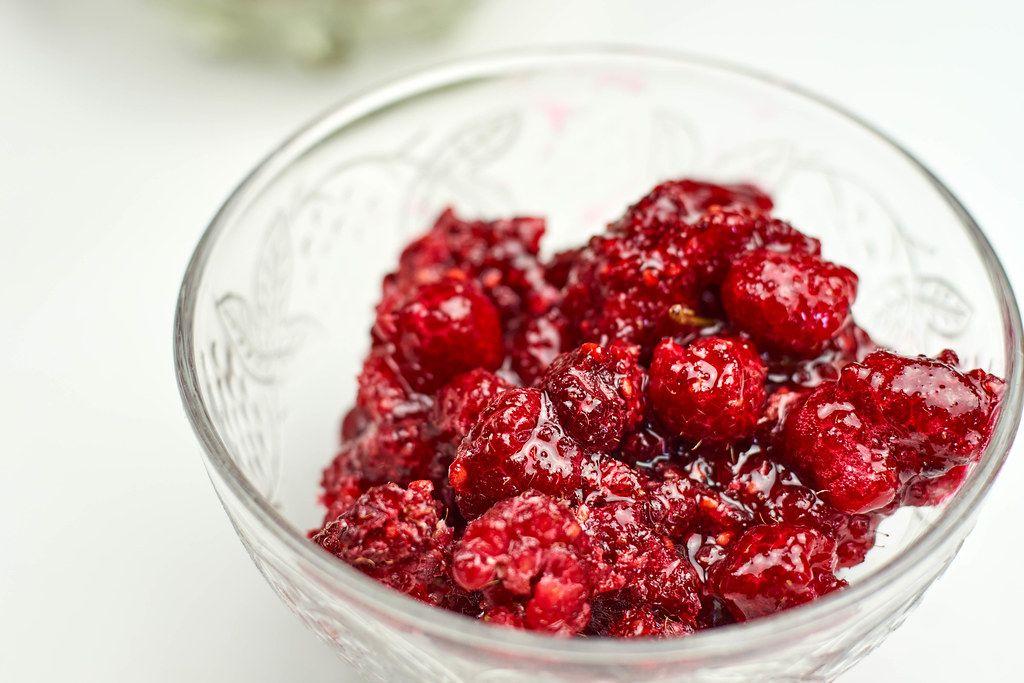 A bowl of raspberry jam
