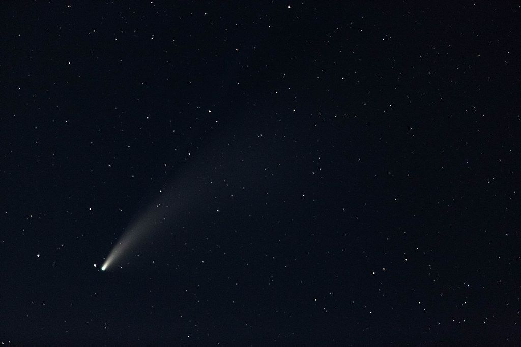A comet passing near the earth with a glowing tail