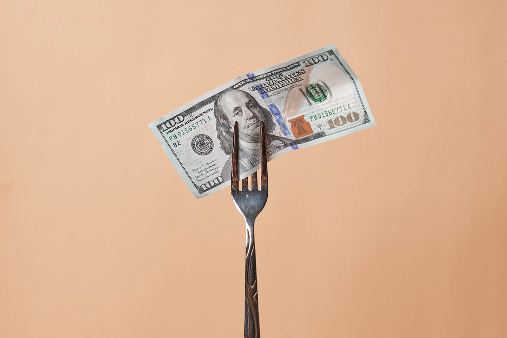 A fork with hundred dollar bill
