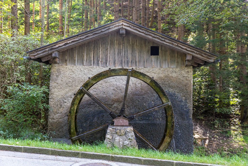 A functioning watermill with water wheel at the roadside in Tyrol (Austria)