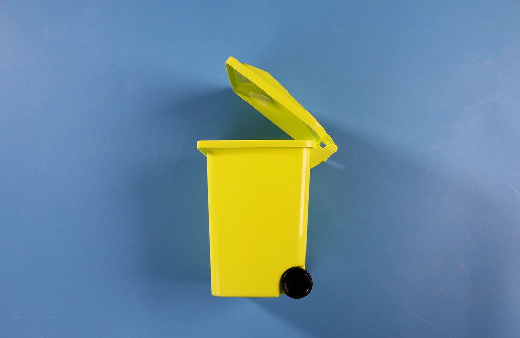 A garbage can on blue background