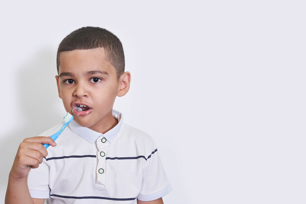 A little boy with toothbrush