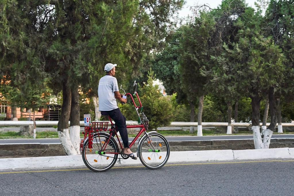 A man riding a unique bike