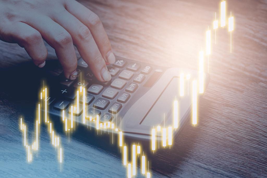 A person calculating economic loss or income