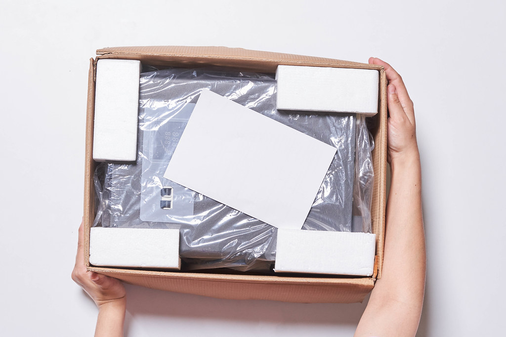 A person unpacking a new voltage stabilizer