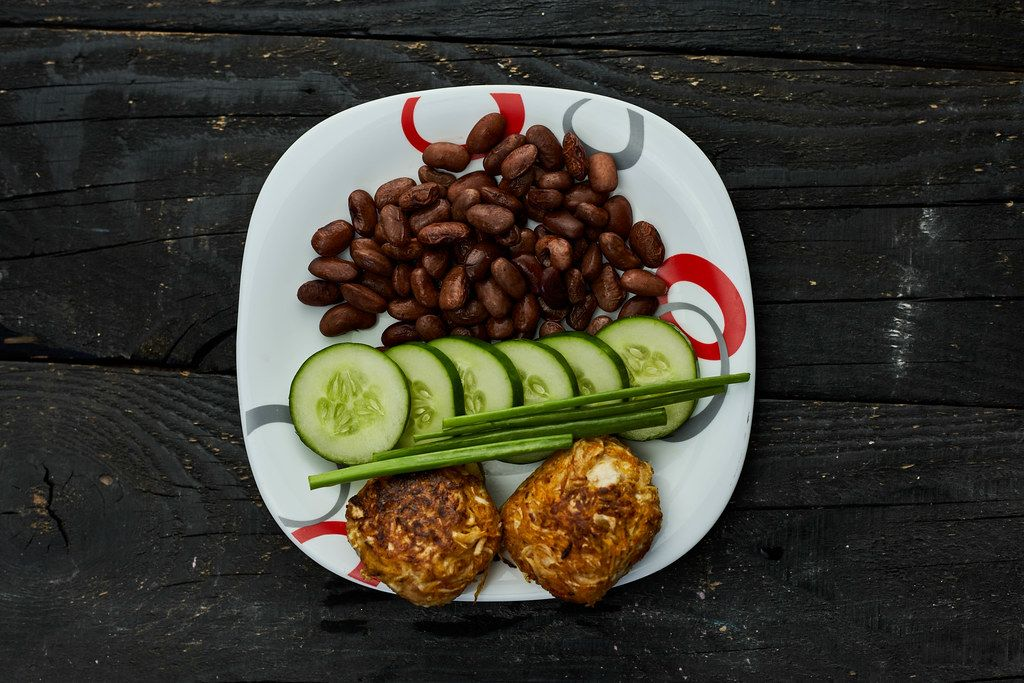 A plate of dieting healthy lunch on the dark wood background