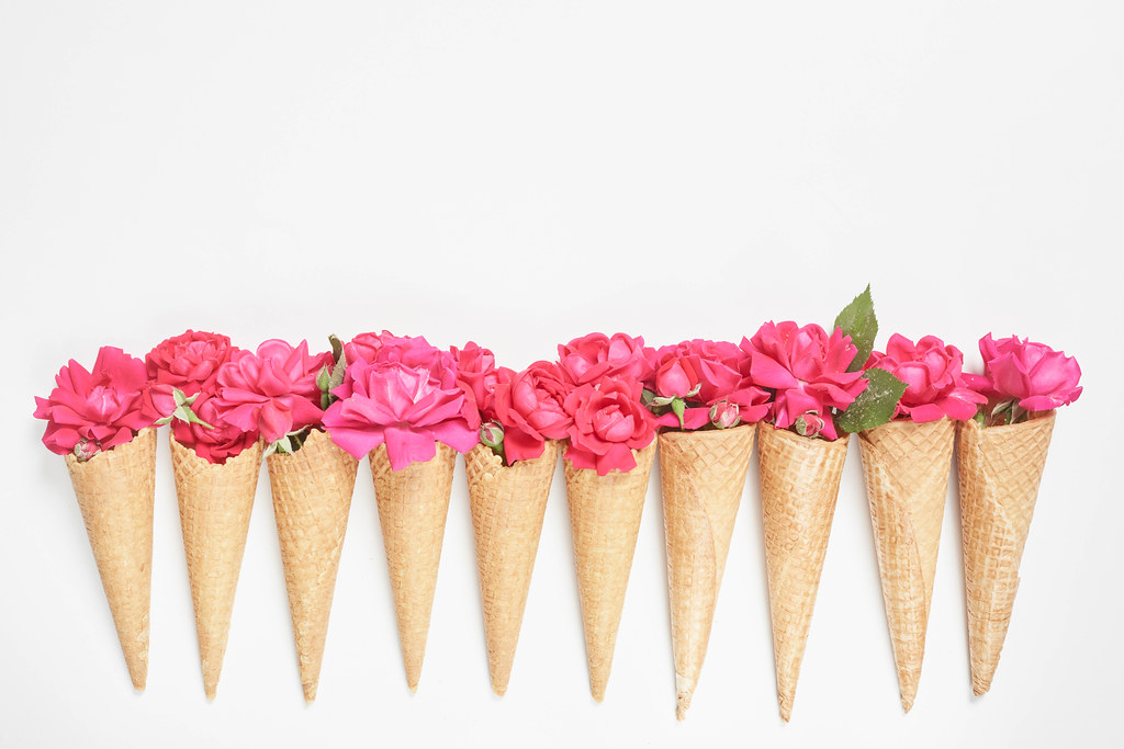 A row of creative flower bouquets with waffle cones