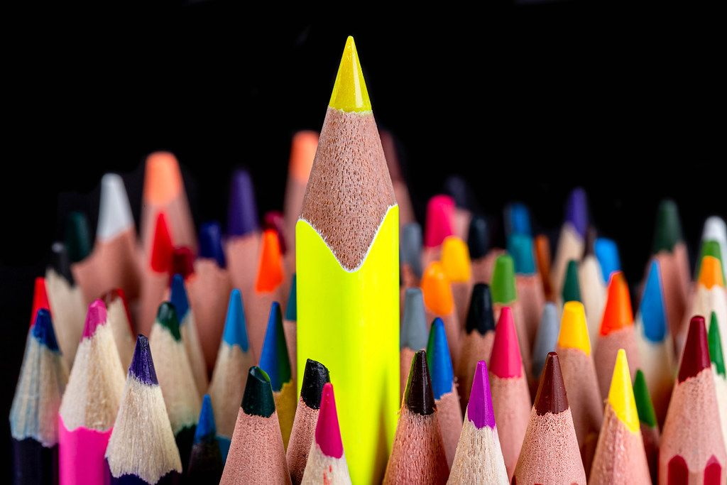 A sharp yellow pencil towers over many others