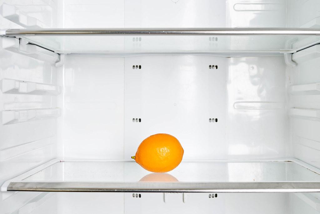 A single lemon in the fridge
