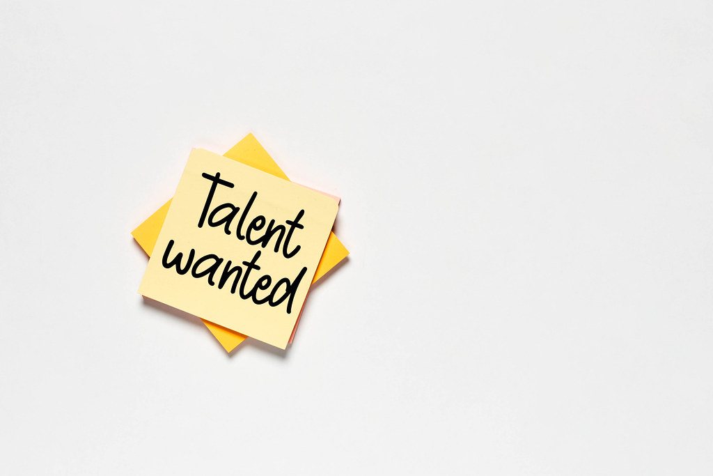 A sticky note with 'Talent wanted' text on white backdrop