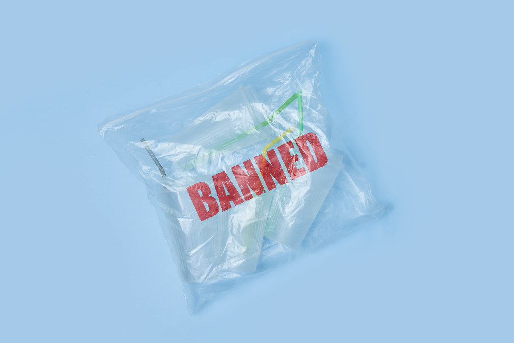 A transparent bag full of plastic sing-use mugs with Banned stamp