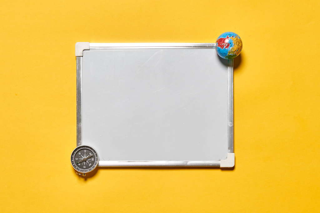 A white board with copy space on yellow background