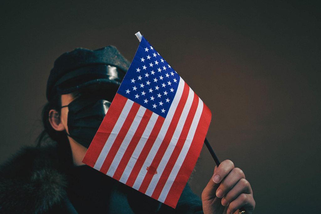 A woman holding american flag