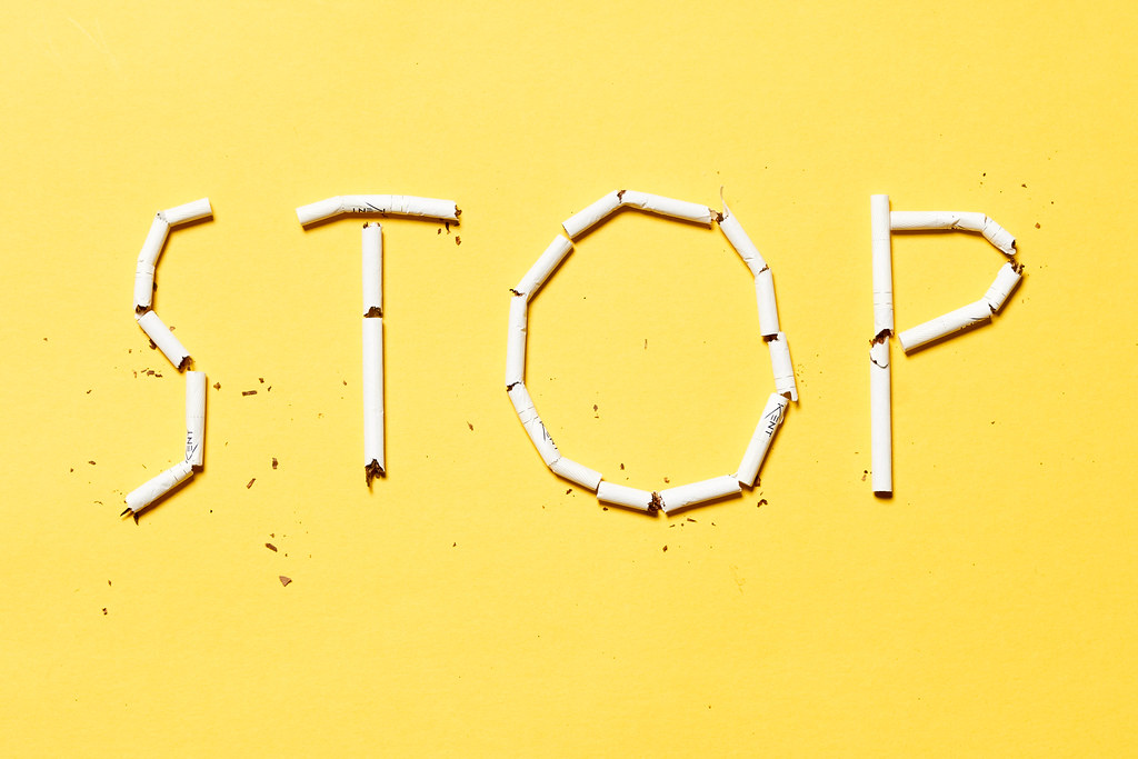 A word 'Stop' made with cigarettes