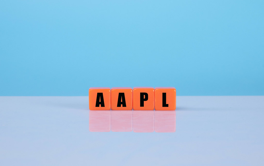 AAPL text on orange cubes