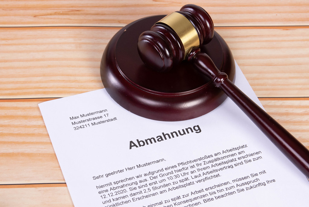 Abmahnung document with a wooden judge gavel